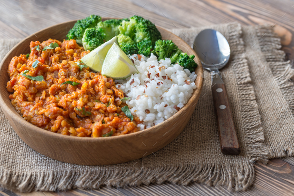 Bowl of red lentil curry with white rice and broccoli - Stock Photo - Images