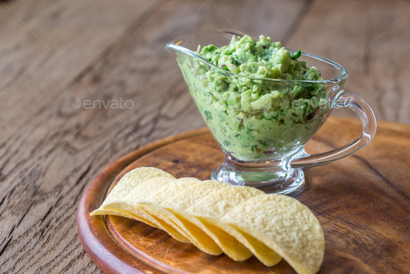 Guacamole with chips on the wooden board - Stock Photo - Images