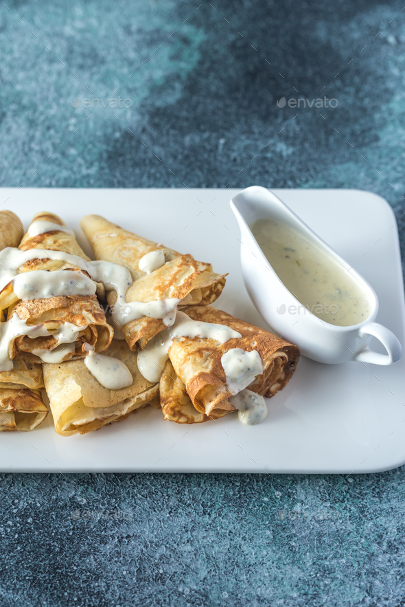 Crepes with blue cheese sauce - Stock Photo - Images