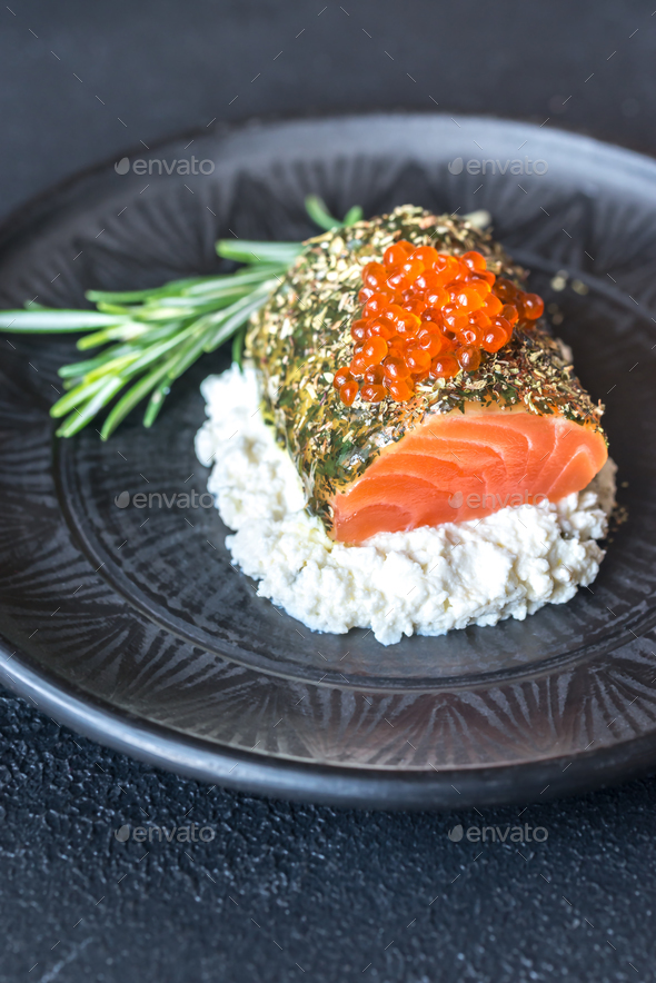 Salmon in mint sauce with red caviar and ricotta - Stock Photo - Images