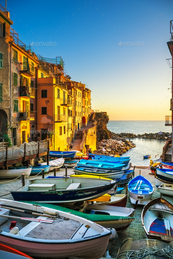 Riomaggiore village street, boats and sea. Cinque Terre, Ligury, - Stock Photo - Images
