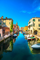 Chioggia town in venetian lagoon, water canal and church. Veneto - PhotoDune Item for Sale