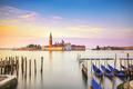 Venice lagoon, San Giorgio church, gondolas and poles. Italy - PhotoDune Item for Sale