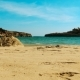 View of the Sandy Beach Near the Turquoise Sea Between the Rocks Europe - VideoHive Item for Sale