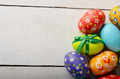 Painted decorated easter eggs on white table - PhotoDune Item for Sale