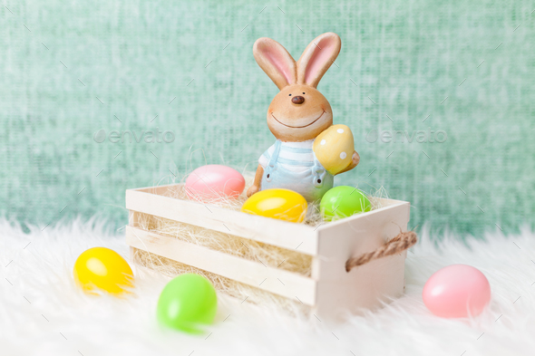 Easter holiday basket with a bunny and eggs - Stock Photo - Images