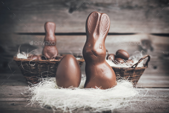 Chocolate Easter bunny and eggs on wooden backround - Stock Photo - Images