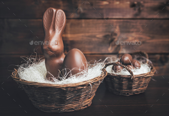 Chocolate Easter bunny inside a basket - Stock Photo - Images