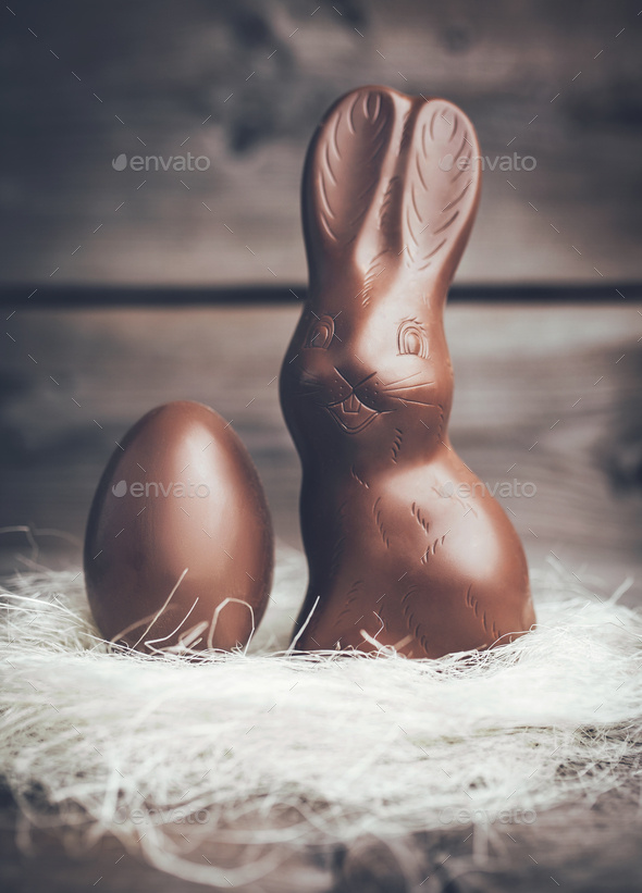 Chocolate Easter bunny and egg on wooden backround - Stock Photo - Images