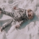A Little Girl Makes Snow Angels in Snow - VideoHive Item for Sale