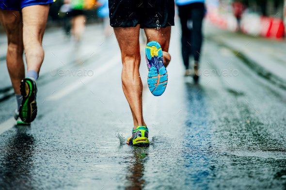 water sprays from under running shoes runner men - Stock Photo - Images