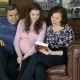 Elderly Parents and Daughter Are Viewing a Family Photo Album - VideoHive Item for Sale