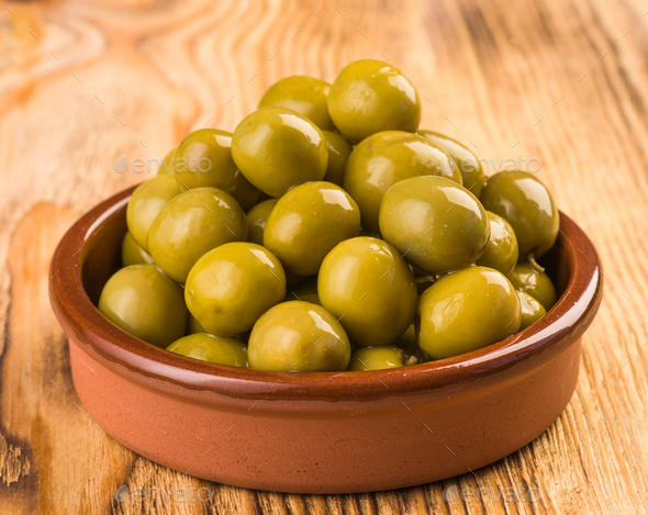 olives in classic mud pie - Stock Photo - Images