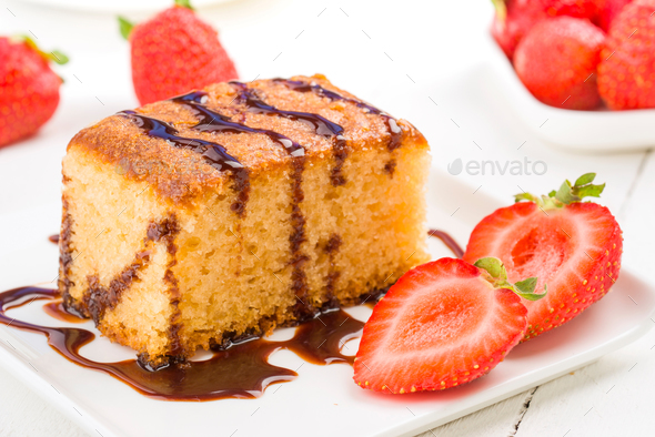 sweet cake with cut strawberry on white table - Stock Photo - Images