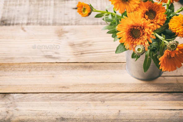 Calendula on wooden table, copy space, view from above - Stock Photo - Images