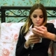 Young Business Woman in Suit Uses Smartphone on the Sofa - VideoHive Item for Sale