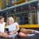 Mother and Girl Using Phone in Gym for Watching Video How Do Jumping Exercise - VideoHive Item for Sale