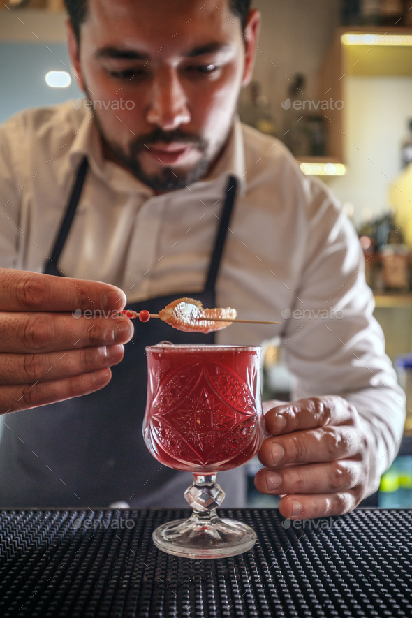 Bartender creates cocktail - Stock Photo - Images