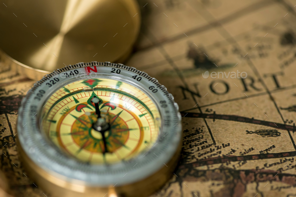 Old compass on vintage map - Stock Photo - Images