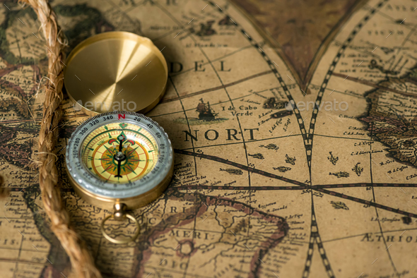 Old compass on vintage map with rope - Stock Photo - Images