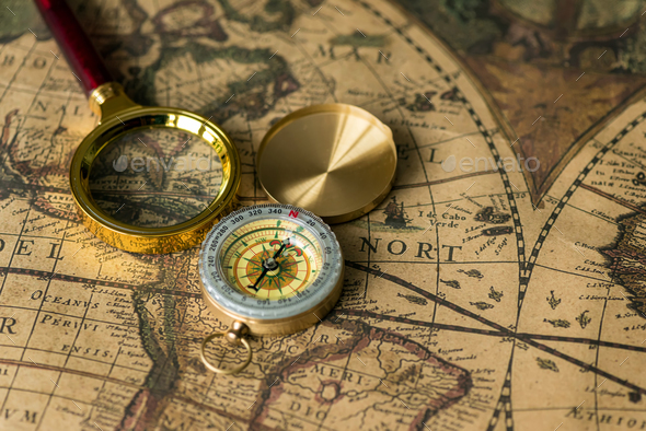 Retro compass with old map and magnifier - Stock Photo - Images