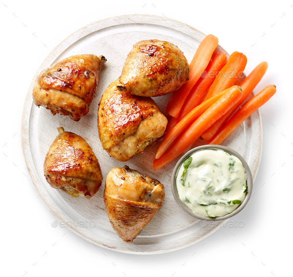 grilled chicken legs on wooden cutting board - Stock Photo - Images