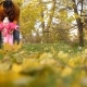 Baby with His Father Walk with Their Feet on Autumn Leaves - VideoHive Item for Sale