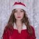 Santa Girl Starts Smiles on Bokeh Background - VideoHive Item for Sale