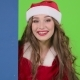Santa Woman Looks Out of the Blue Board and Shows a Thumbs up - VideoHive Item for Sale