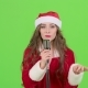 Girl in the Suit of Santas Assistant Sings in a Retro Microphone and Dances with Energetic Music - VideoHive Item for Sale