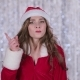 Santa Claus Girl in Red Suit Points Her Finger a Little More Quietly - VideoHive Item for Sale