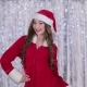 Santa Woman Winks at Her Friend. Bokeh Background - VideoHive Item for Sale