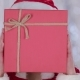 Santas Assistant Covered Her Face with a Gift and Looked Out for Him. Bokeh Background. - VideoHive Item for Sale