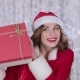 Girl in a Snow Maiden Costume Holds a Gift in Her Hand. Bokeh Background. - VideoHive Item for Sale