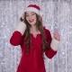 Snow Maiden Sings Christmas Songs in Her Headphones. Bokeh Background - VideoHive Item for Sale