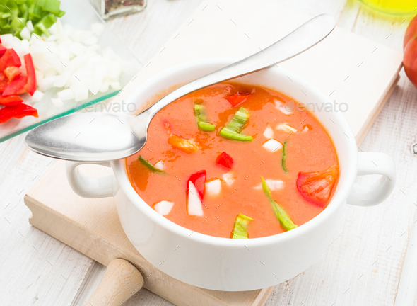 gazpacho soup with spoon in white china bowl - Stock Photo - Images