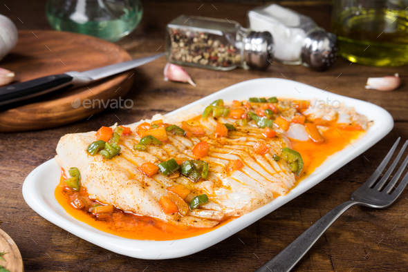 fresh cod fillet cooked in classic wood - Stock Photo - Images