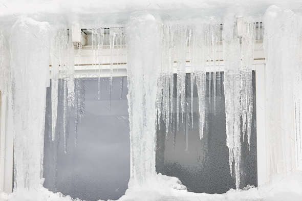 Icicle windows on winter time. Freeze temperatures backgrounds. Horizontal - Stock Photo - Images