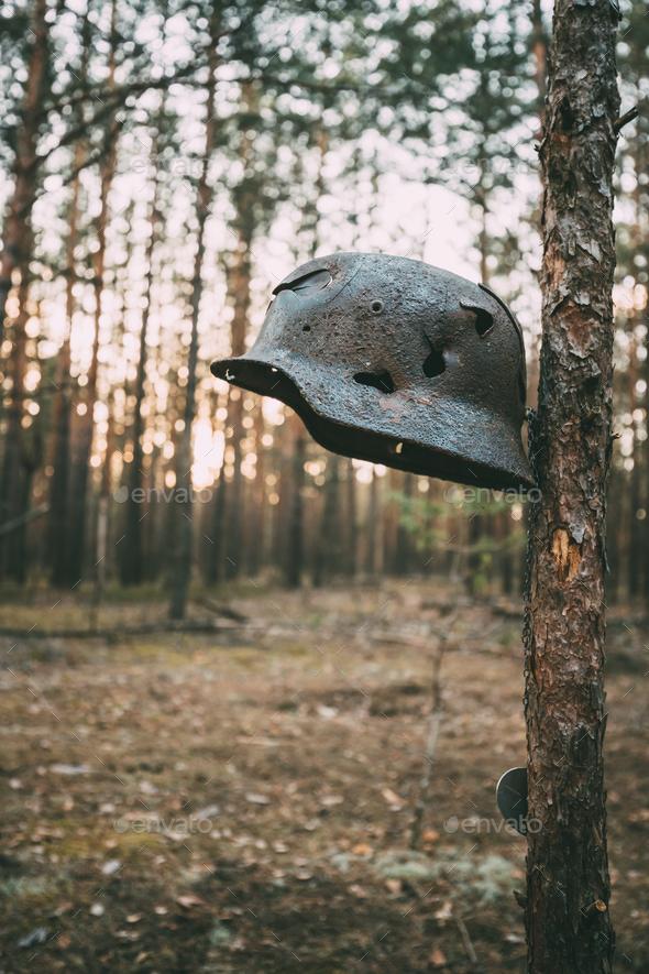Damaged By Bullets And Shrapnel Metal Helmet Of German Infantry - Stock Photo - Images
