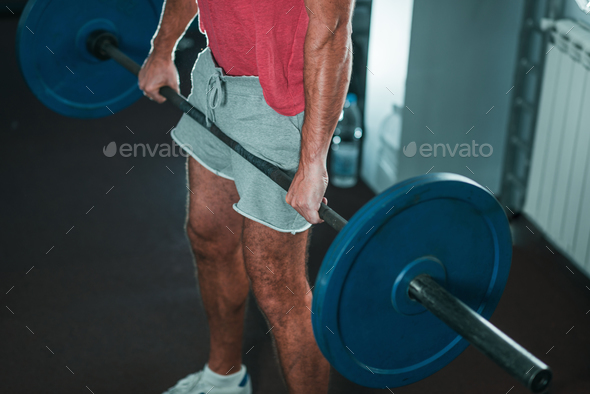 Man weightlifting on training - Stock Photo - Images