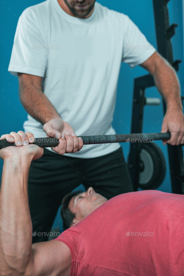 Peronal trainer with male client in the gym - Stock Photo - Images