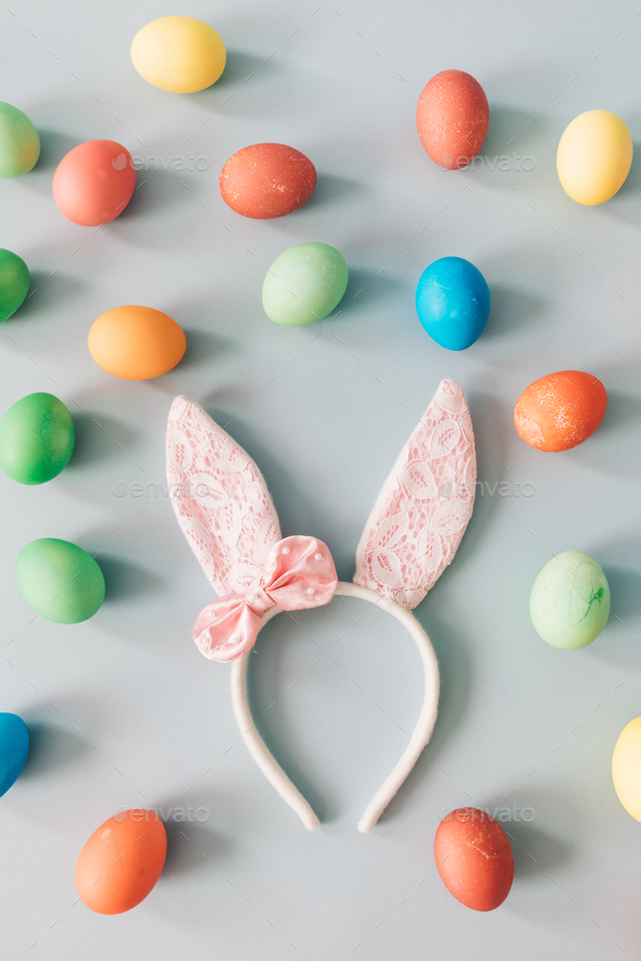 Bunny ears surrounded by Easter eggs. - Stock Photo - Images