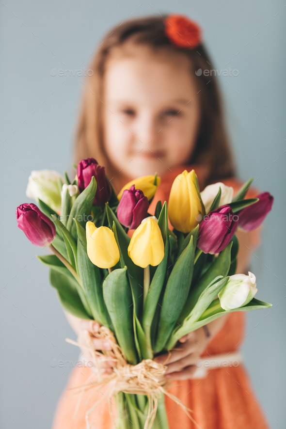 Young girl holding Mother's day gift. - Stock Photo - Images