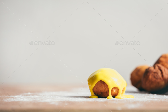 Little round donut with yellow icing - Stock Photo - Images