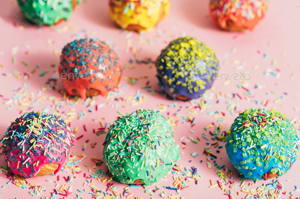 Colorful donuts with sugar strands on a messy background - Stock Photo - Images