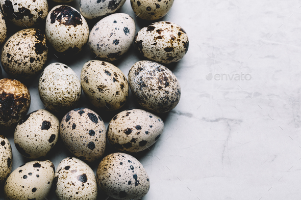 Group of quail eggs on a marble background - Stock Photo - Images