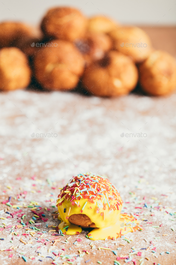 Yellow doughnut decorated with sugar strands - Stock Photo - Images
