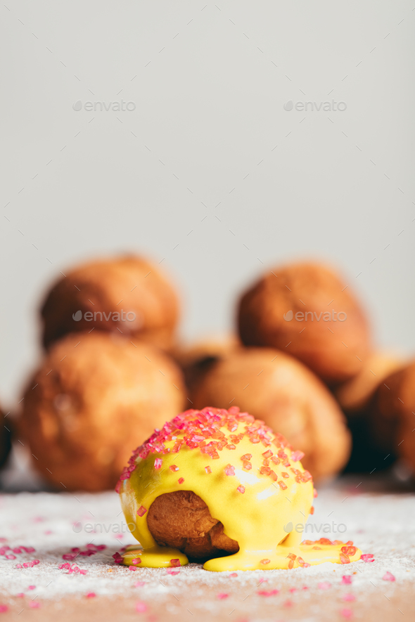 Little yellow doughnut laying on the kitchen table - Stock Photo - Images