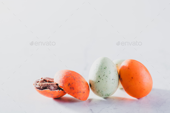 Three colorful eggs on a light background. - Stock Photo - Images