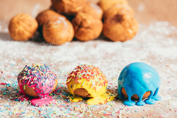 Three homemade doughnuts on a dirty counter - Stock Photo - Images